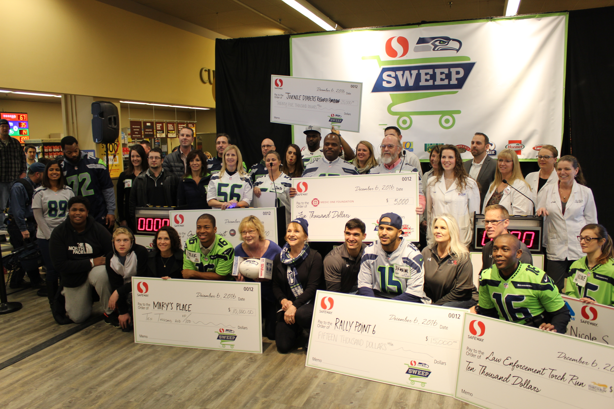 2nd Annual Safeway Seahawk Sweep Brings in Big Bucks for Charity